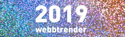 Årtalet 2019 och ordet webbtrender mot en glittrande regnbåge